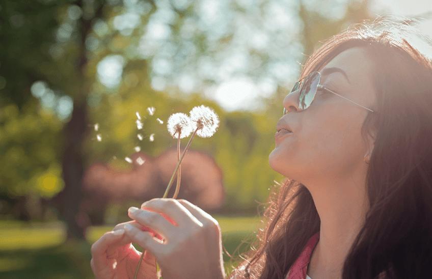 allergies - girl blowing flowers