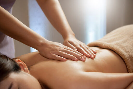 Woman lying on a table getting a massage.
