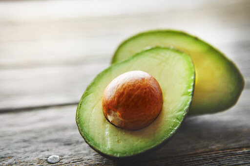An avocado sliced in half.